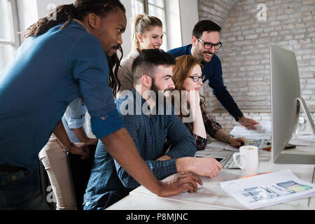 Young architects working on project in office - Stock Photo