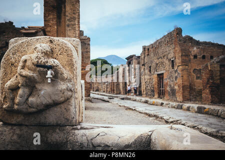 public fountain with hercules that kills the lion in the streets of Pompeii - Stock Photo
