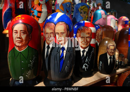 Traditional Matryoshka dolls depicting US President Donald Trump, Russian President Vladimir Putin and Chinese chairman Mao for sale in a souvenir stall in the city of Kiev capital of Ukraine - Stock Photo