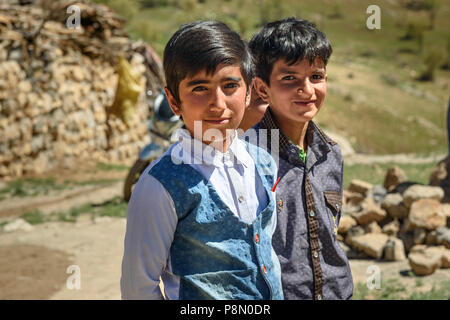 Lorestan Province, Iran - April 1, 2018: Iranian young boys on wedding ceremony in the village. - Stock Photo