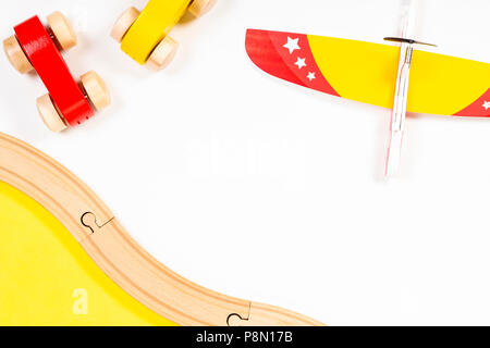 Colorful kids toy plane and wooden cars on white background - Stock Photo