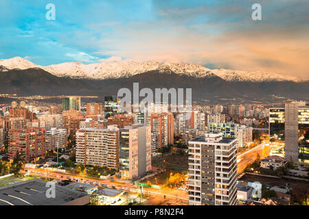 Apartment buidings in the wealhty district of Las Condes with The Andes mountain Range in the back, Santiago de Chile - Stock Photo