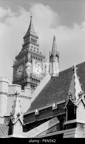 Palace of Westminster, Greater London. General view of the Houses of Parliament showing the clock tower 'Big Ben' and roofs. The clock face shows eigh - Stock Photo