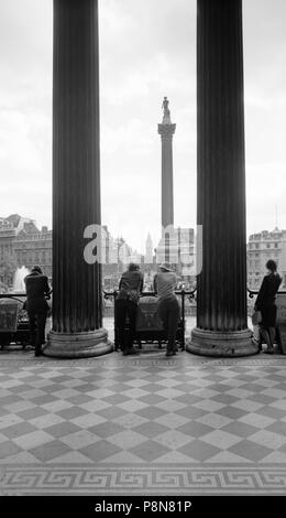 Trafalgar Square, Westminster, London, c1945-c1980. Trafalgar Square and Nelson's Column seen from the portico of the National Gallery. The 'Big Ben'  - Stock Photo