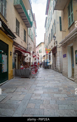 Villefranche Sur Mer, France, Jne 2018, views of streets in the town where tourists wander admiring the sights and seeking food. - Stock Photo