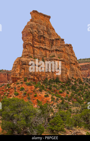 Dramatic Butte Soaring into the Sky at Colorado National Monument in Colorado - Stock Photo