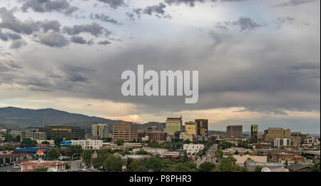 Boise, Idaho. Cityscape with a view from the west at sunset in summertime. Downtown streets and skyscrapers and the Boise Foothills. - Stock Photo