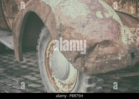 Rusty crumpled front wing with the wheel and tire vintage car - Stock Photo