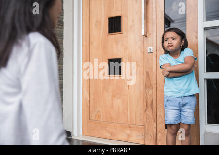 Portrait of asian mother scolding to her daughter - Stock Photo