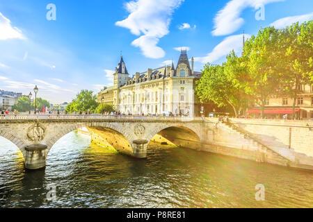 Pont au Change at sunset, bridge over river Seine and Conciergerie, a historic Parisian building within Palais de Justice complex, Ile de la Cite.Castle in former royal palace and prison Paris, France - Stock Photo