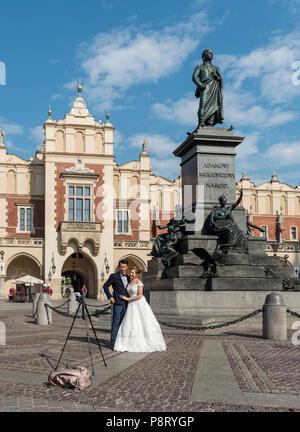 Chinese wedding in front of Cloth Hall (Sukiennice) in Main Market Square, Krakow, Poland - Stock Photo