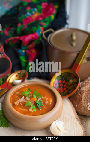 Traditional Ukrainian red soup from vegetables and meat. Photo in a rustic vintage style. Place for text. Copy space - Stock Photo