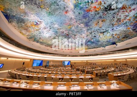 Geneva, Switzerland, 18 August 2016: The Human Rights and Alliance of Civilizations Room in the Palais des Nations, the United Nations Office at Geneva (UNOG). The room is one of the largest conference rooms at the UNOG. On the ceiling is a sculpture from | usage worldwide - Stock Photo