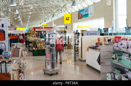 Olbia,Italy,14-april-2018:People shopping at the olbia airpoert tax free shop on sardinia island, tis is one of the three airports of sardinia - Stock Photo