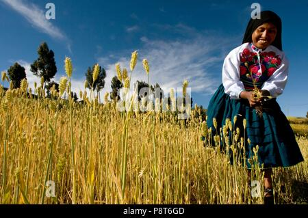 A woman from the island of Amantaní dressed in her typical regional costume. Amantani Island, Lake Titicaca, Puno, Peru January 2018 | usage worldwide - Stock Photo