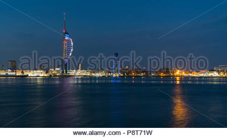 Night time view of Portsmouth and the Emirates Spinnaker Tower from Gosport looking across Portsmouth Harbour in Hampshire, England, UK. - Stock Photo