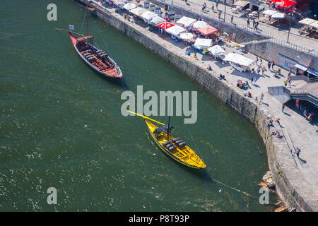 Two Rabelo boats moored at the riverside in Oporto, Portugal, used in the past to transport people and port wine on the river Douro - Stock Photo