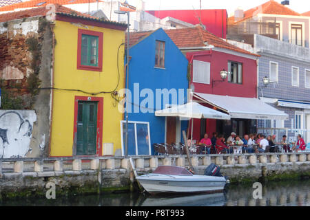 Canal waterfront and restaurant in front of old fishermen's houses at Aveiro, Portugal - Stock Photo