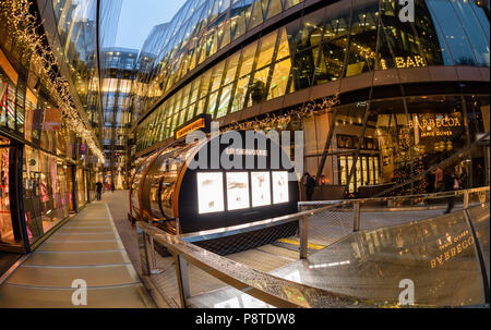 A few last minute Christmas shoppers at One New Change, London, showing Jamie Olivers restaurant Barbecoa - Stock Photo