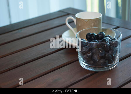 Morning cup of coffee on the balcony. Healthy breakfast. - Stock Photo