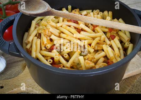 pan-fried pasta and pork à la provençale - Stock Photo