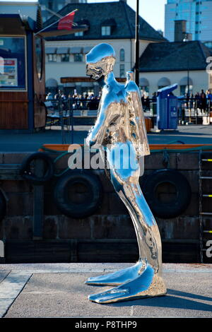 OSLO - MARCH 21: Contemporary scuplture of a diverr in Oslo harbour created by sculptor Ola Enstad - Stock Photo