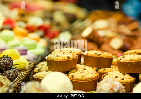 counter with different sweets in the market - Stock Photo