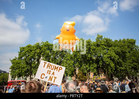 London/United Kingdom - July 13, 2018: Donald Trump's visit to England is met with protests and a blimp flying over London's Parliament Square. The blimp hovers over the square. - Stock Photo