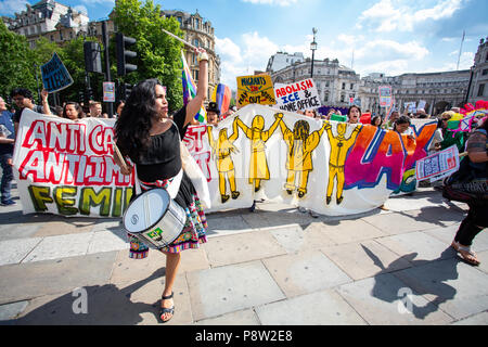 London/United Kingdom - July 13, 2018: Protests against Donald Trump continue with a march in central London ending up in Trafalgar Square for a rally. The lead group arrives! Credit: Martin Leitch/Alamy Live News - Stock Photo