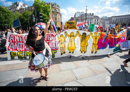 London/United Kingdom - July 13, 2018: Protests against Donald Trump continue with a march in central London ending up in Trafalgar Square for a  rally.  Entering Trafalgar Square. Credit: Martin Leitch/Alamy Live News - Stock Photo
