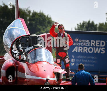 Fairford, UK, 13 July 2018. A Red Arrow pilot acknowledges the crowd after getting out of his jet after another stunning display on the first day of the 2018 Royal International Air Tattoo in Fairford, England (picture taken 13 July 2018) Credit: Ceri Breeze/Alamy Live NewsCredit: Ceri Breeze/Alamy Live News  - Stock Photo