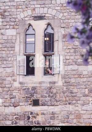 n off duty soldier observes the crowds below from a turret window in Windsor Castle, Windsor, Berkshire, UK Bridget Catterall Alamy Live News UK - Stock Photo