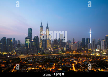 Kuala lumpur cityscape. Panoramic view of Kuala Lumpur city skyline during sunrise viewing skyscrapers building and Petronas twin tower in Malaysia. - Stock Photo