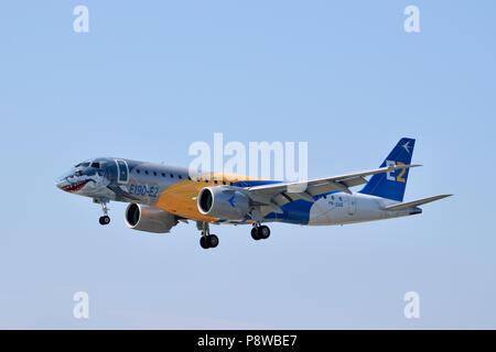 The all new Embraer E190 E2 medium range jet airliner makes its maiden arrival to London City Airport located in London's Royal Docks - Stock Photo