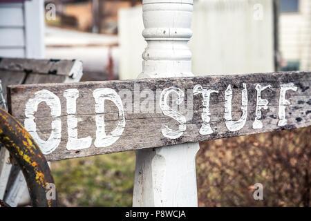 "Vintage ""Old Stuff"" Wood Sign on White Wood Post - Stock Photo"