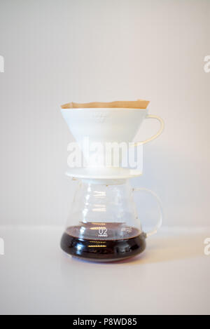 v60 pour over brewing method.  Filter coffee paper.  Drip coffee.  Coffee at home. - Stock Photo