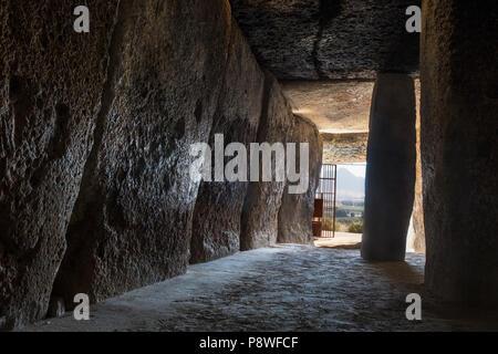 Antequera, Spain - July 10th, 2018: Dolmen of Menga, Antequera. Interior chamber pointing to Pena de los Enamorados mountain - Stock Photo