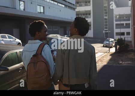 Twins siblings walking in city street - Stock Photo