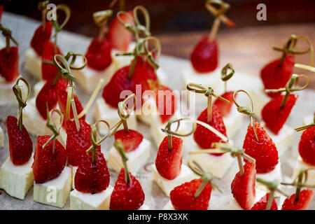 Catering for the wedding Banquet. Strawberry and cheese canap  - Stock Photo