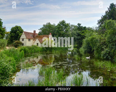 Flatford mill Willy Lotts cottage on the river Stour East Bergholt in the Dedham Vale made famouse by the artist John Constable - Stock Photo