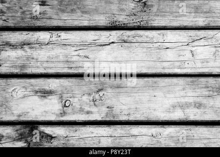 Weathered wooden floorboards background texture in black and white - Stock Photo