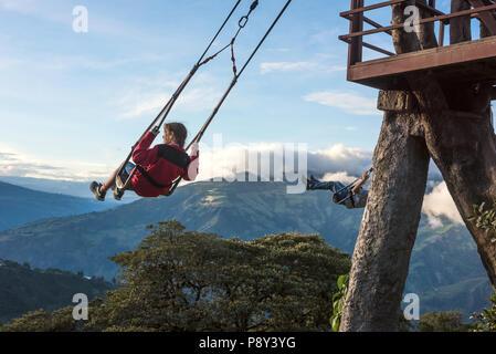 Banos, Ecuador - November 22, 2017: The Swing At The End Of The World Located At Casa Del Arbol, The Tree House In Banos De Aqua Santa, Ecuador, South - Stock Photo