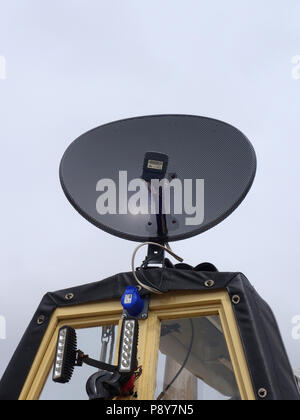 Narrowboat spare room cratch with Satellite TV dish mounted on the roof - Stock Photo