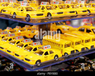 NEW YORK, USA - MAY 2018 - Tiny yellow taxis souvenirs in Manhattan - Stock Photo