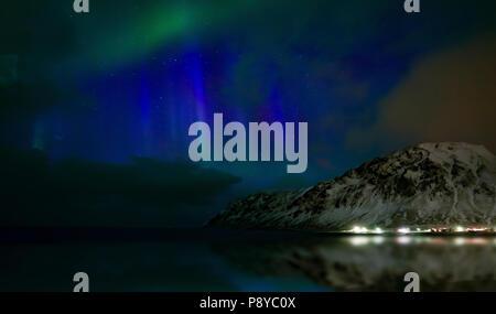 Northern lights, Skagsanden beach, Lofoten Islands, Norway. - Stock Photo