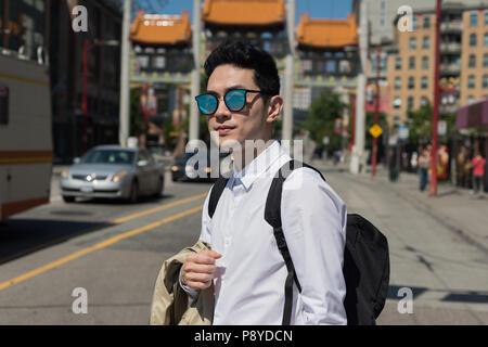 Man crossing the street - Stock Photo