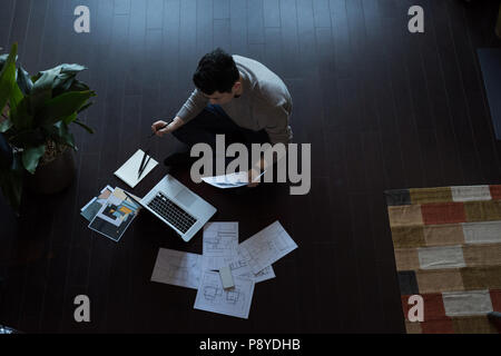 Man working on a project at home - Stock Photo