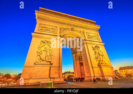 Night view of Arch of Triumph at the center of the Place Charles de Gaulle. Bottom view of popular landmark at blue hour and famous tourist attraction in Paris capital of France in Europe. - Stock Photo