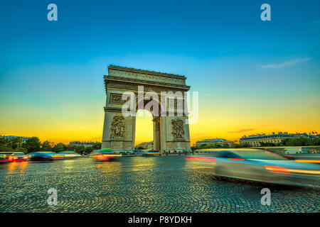 Arch of triumph. Arc de Triomphe at the western end of the Champs Elysees at the center of Place Charles de Gaulle in Paris at sunset with car traffic. Paris capital of France in Europe. - Stock Photo
