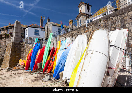 Kayaks and boats in the harbour at Mousehole near Penzance Cornwall England UK Europe - Stock Photo
